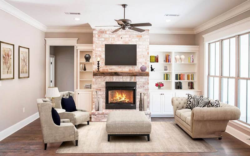 Modern french country living room with brick fireplace and built ins
