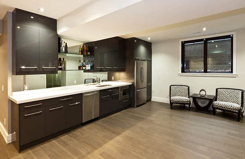 Modern single wall basement kitchen with dark cabinets