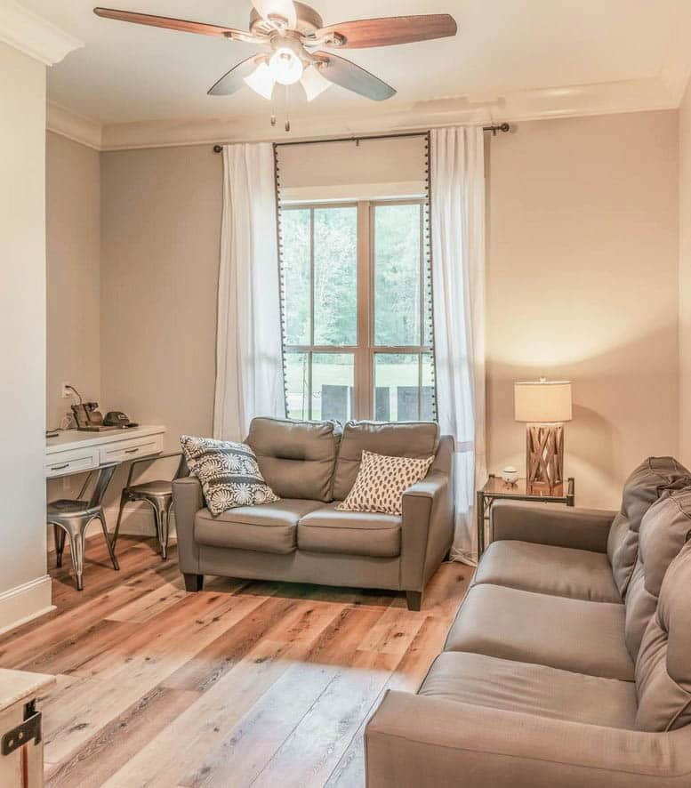 Multi use living room area with built in office nook