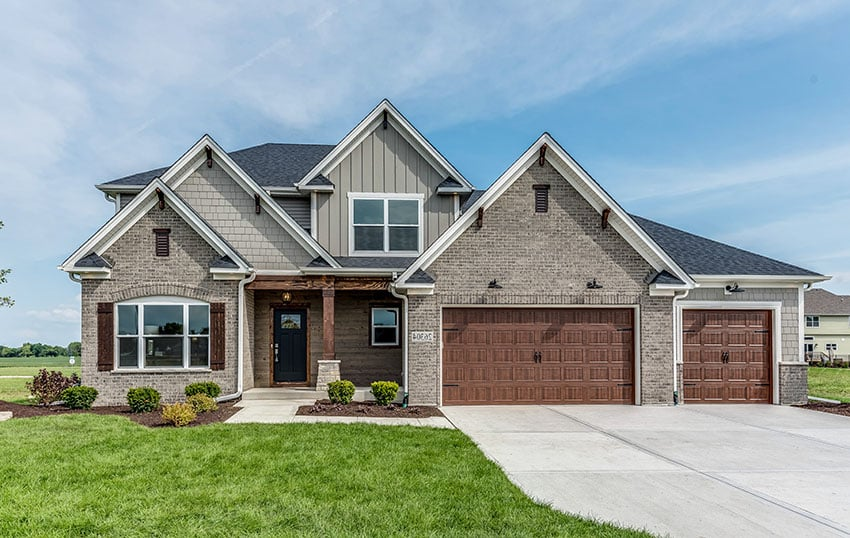New construction home with 3 car garage gray bricks and wall paint