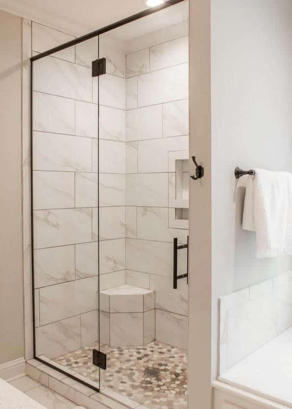 Walk in shower mosaic tile floor black frame