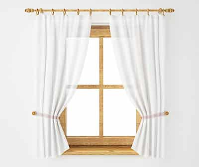 Window with sill length curtains