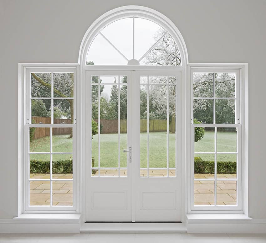 Arched front door with sidelights and transom window