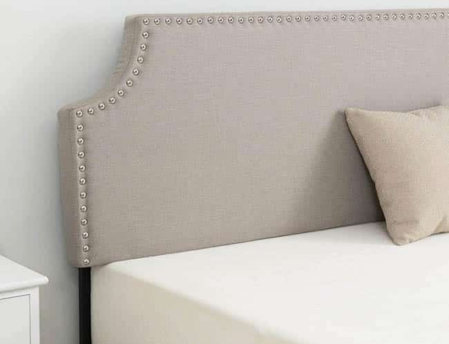 Bed with linen headboard