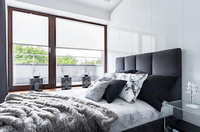 Bed with black fabric headboard