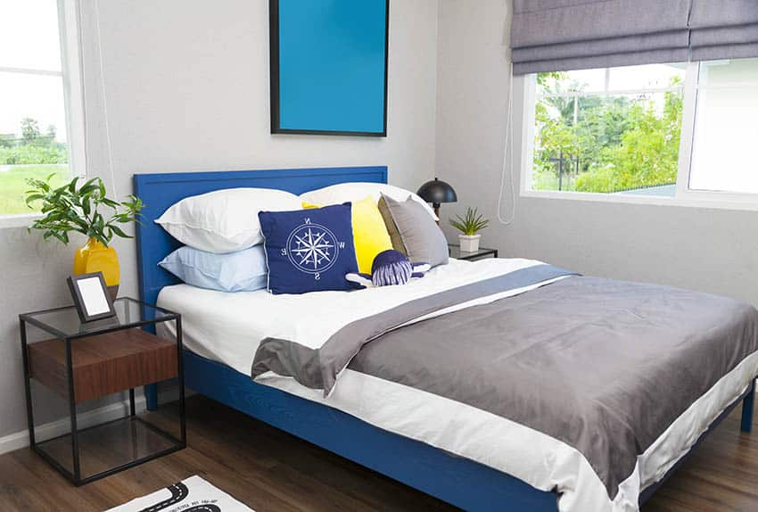 Bed with bright blue painted headboard