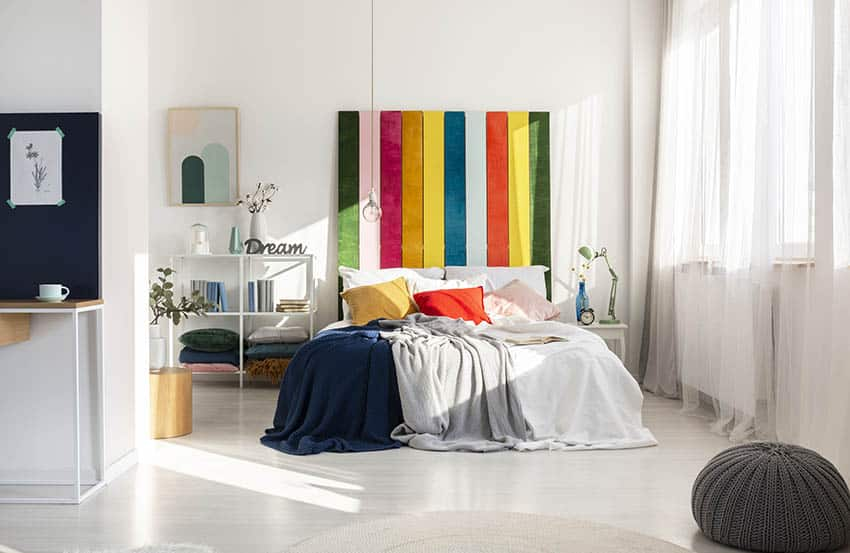 Bed with colorful hanging headboard