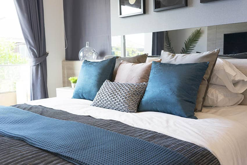 Bed with mirror headboard