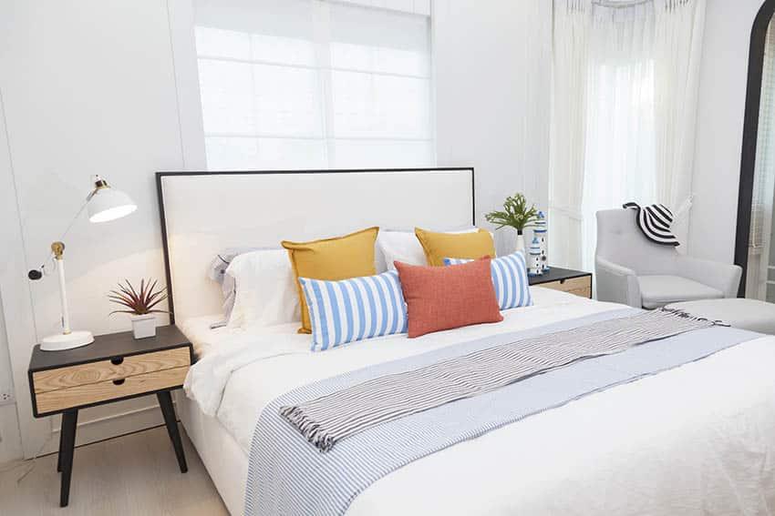 Bed with modern fabric headboard
