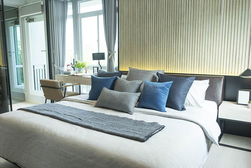 Bed with modern low profile headboard with lights