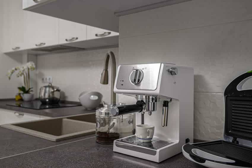 Coffee maker waffle maker countertop sink cabinets kitchen