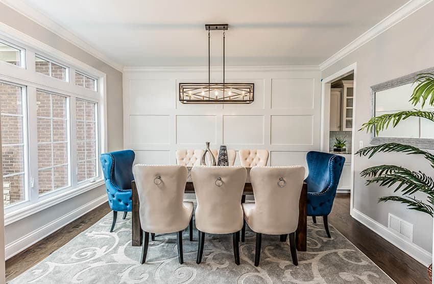 Contemporary dining room table with two types of wingback chairs