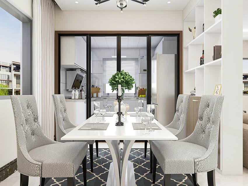 Contemporary dining room with white table and gray chairs area rug