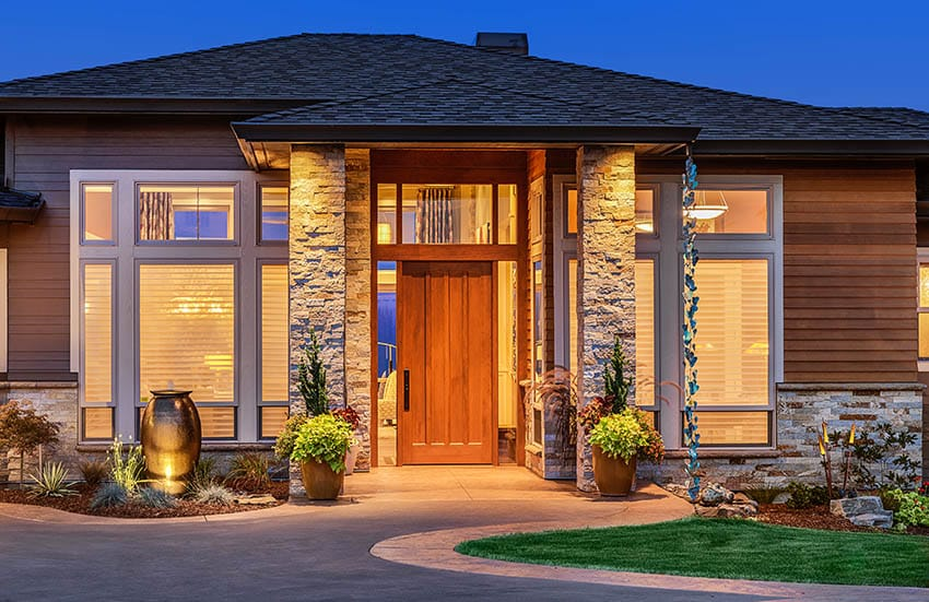 Contemporary home front door with solid glass sidelights and transom window