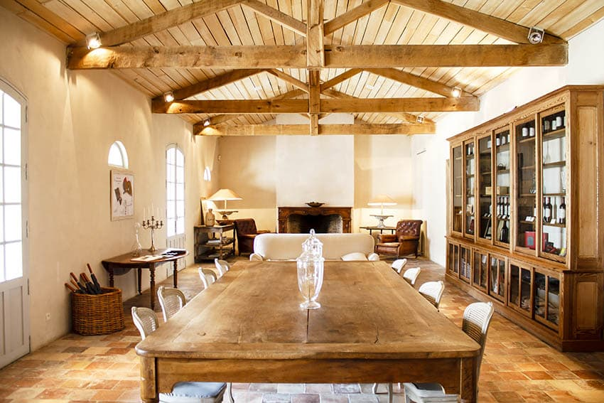 Exposed ceiling truss in open concept dining living room