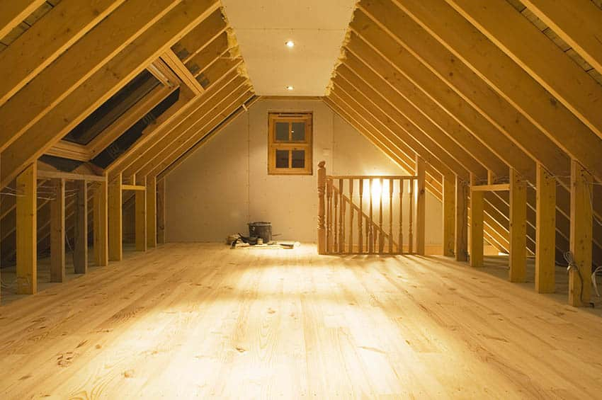 Exposed wood rafters with attic space