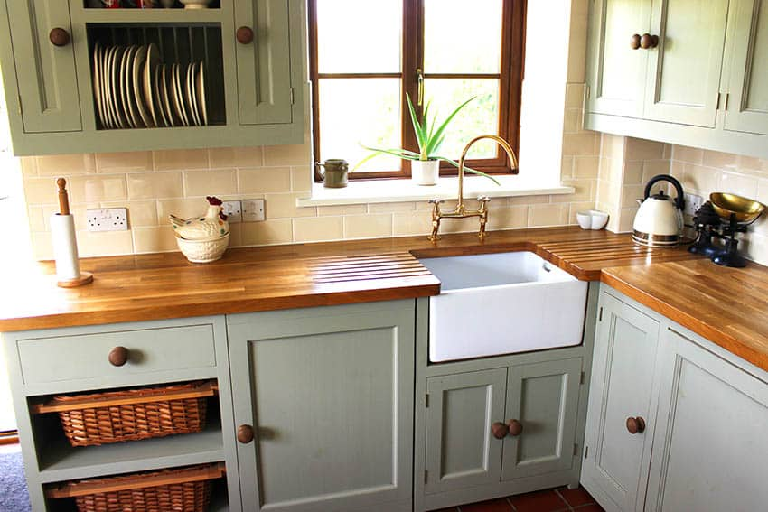 Farmhouse kitchen with butcher block countertops mint green cabinets open dish shelving