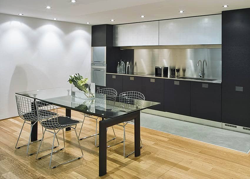 Glass dining table in modern kitchen