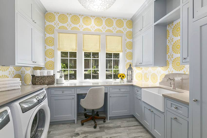 Gray cabinet laundry room with yellow wallpaper