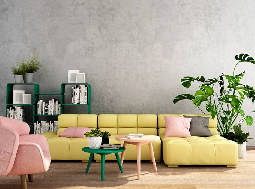 Gray living room with yellow couch pink pillows