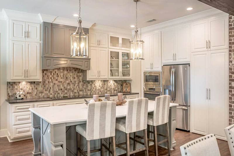 Modern farmhouse kitchen with white cabinets and gray island