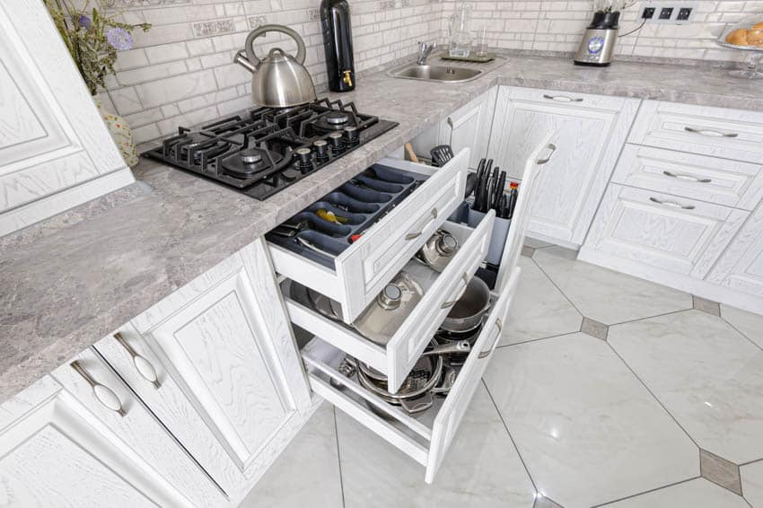 Kitchen cabinet drawers containing kitchenware stove cabinets