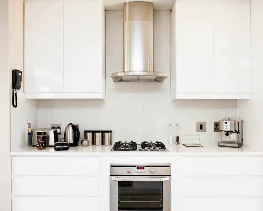 Kitchen space with stove oven hood appliances cabinets drawers