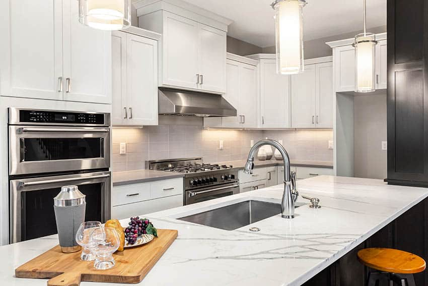 Kitchen with calacatta quartz countertop island grey quartz counters white shaker