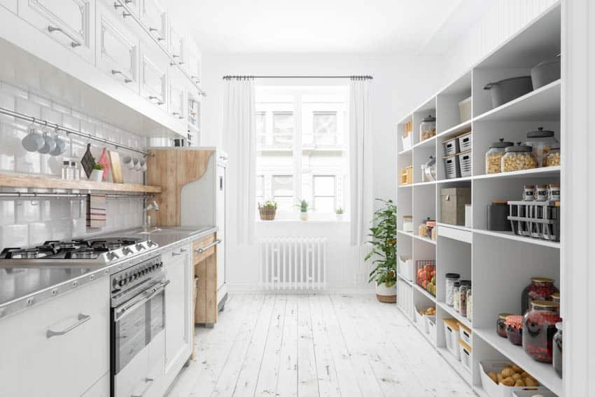 Kitchen with walk in pantry oven stove white cabinets