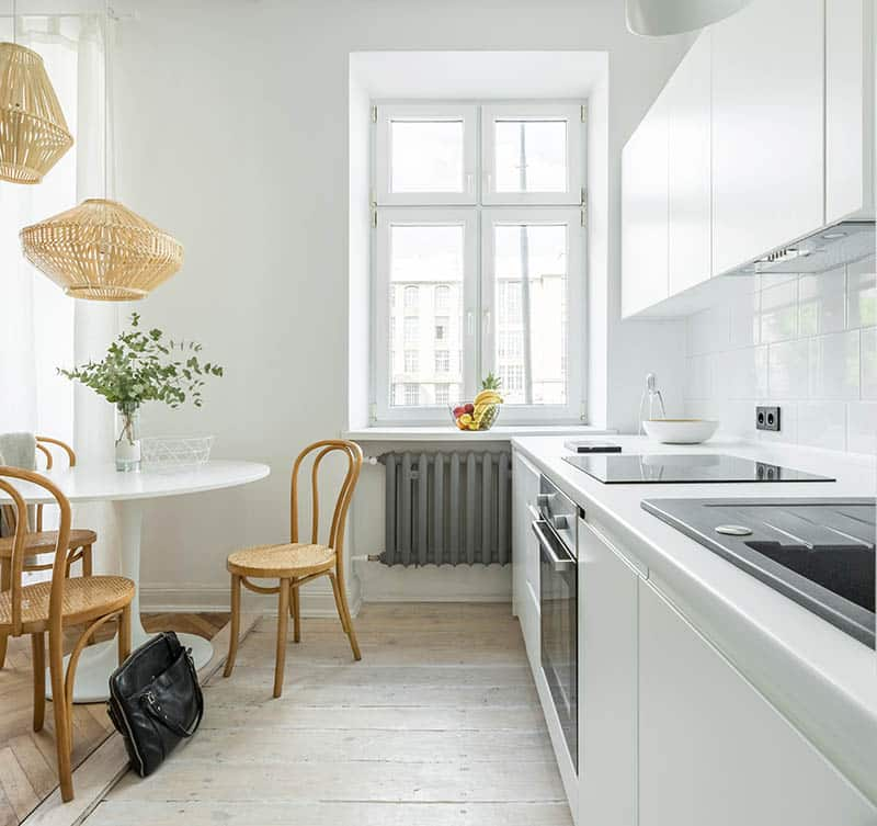 Kitchen with white washed wood flooring