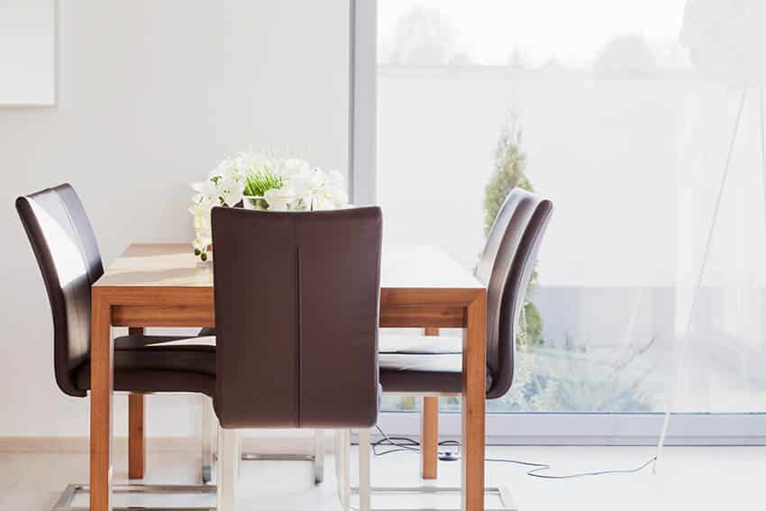 Leather seat chairs with wood table