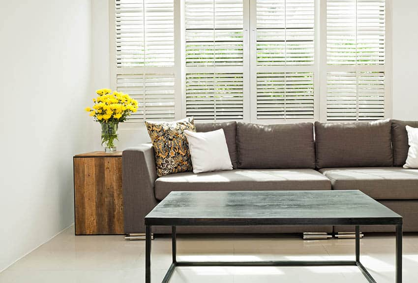 Living room with plantation shutters grey sofa
