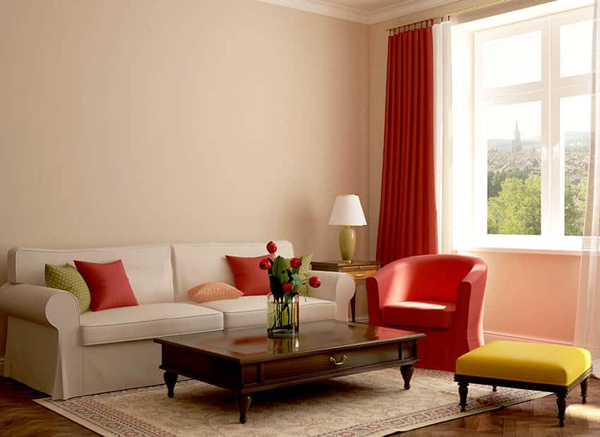 Living room with yellow and red decor with wood coffee table