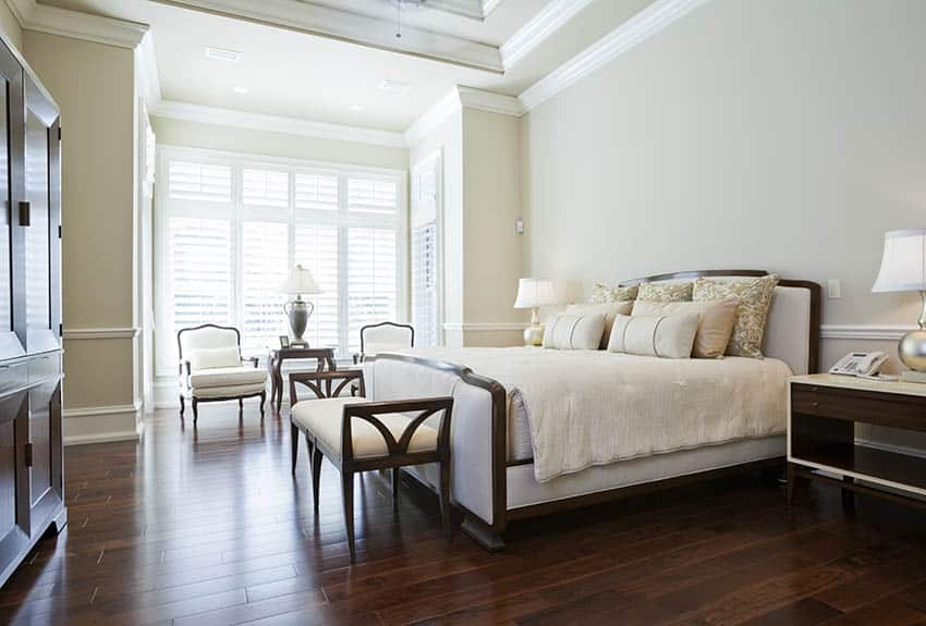 Master bedroom with plantation shutters and cherry wood floors