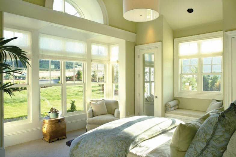 Master bedroom with window seat mirrored closet door