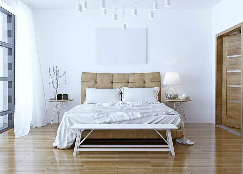 Minimalist bedroom with leather headboard