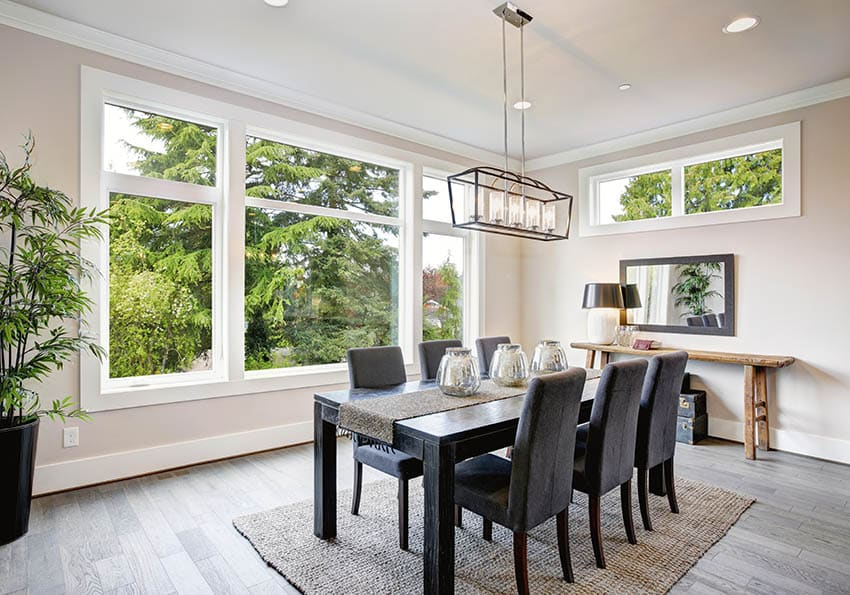 Modern dining room with wood table jute area rug