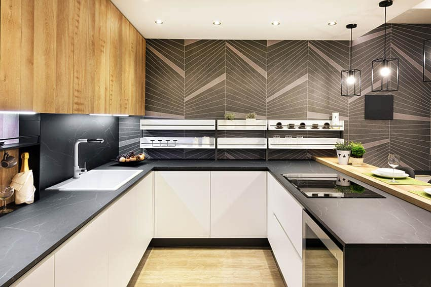Modern kitchen with black soapstone countertops two tone cabinetry