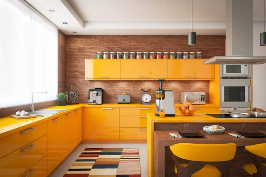 Orange kitchen cabinets appliances oven dining area