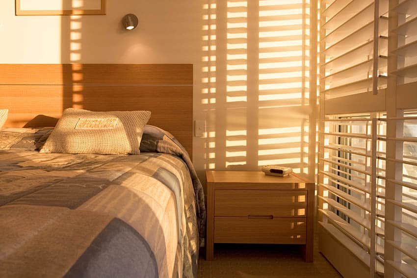 Plantation shutters in bedroom