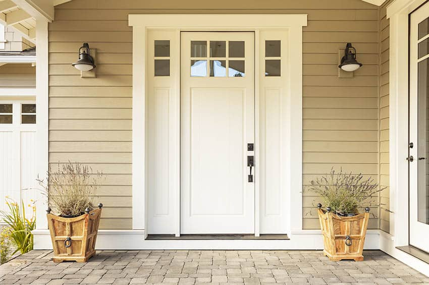 White front door with small upper sidelights