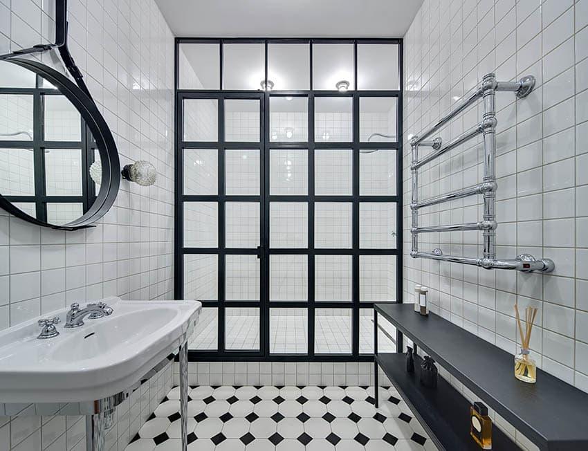 White tile bathroom shower with black frame