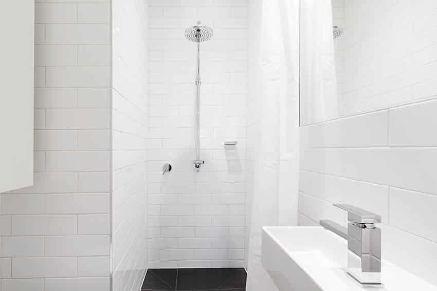 White tile shower bathroom