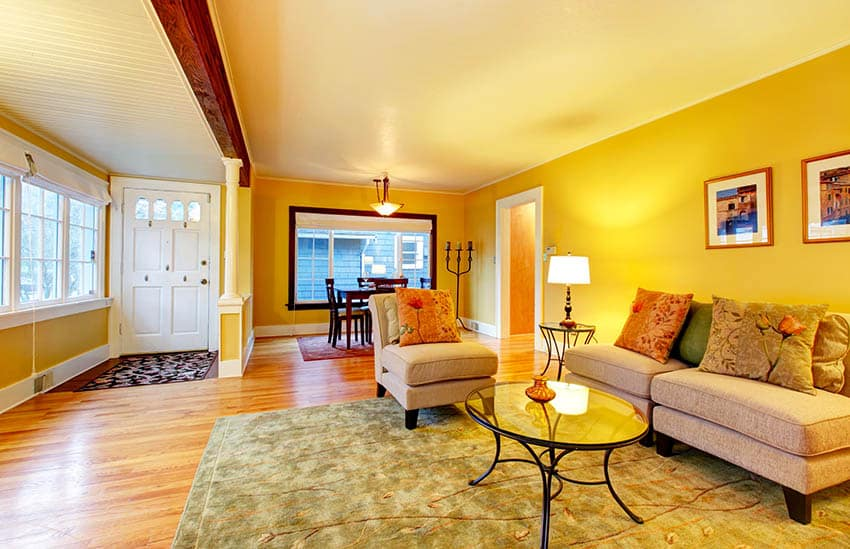 Yellow living room with beige furniture