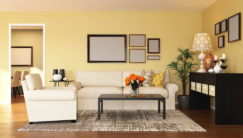 Yellow living room with white couches
