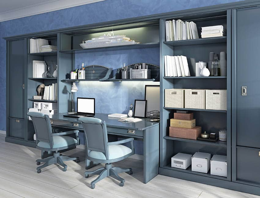 Basement home office with large console desk unit with seating for two
