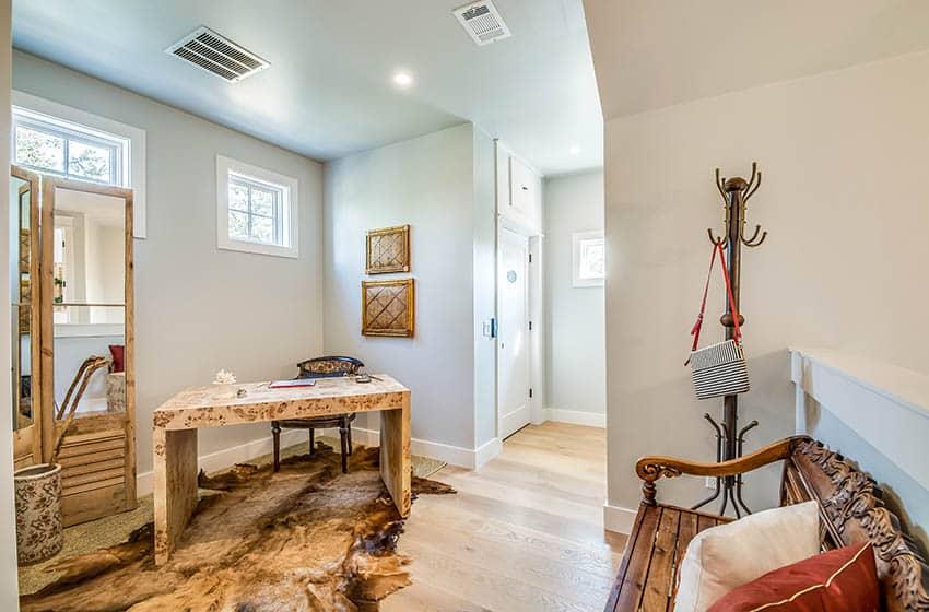 Basement home office with wood flooring recessed lights corner desk