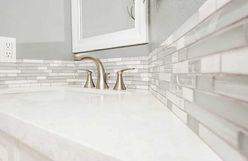 Bathroom with brushed nickel finish faucet