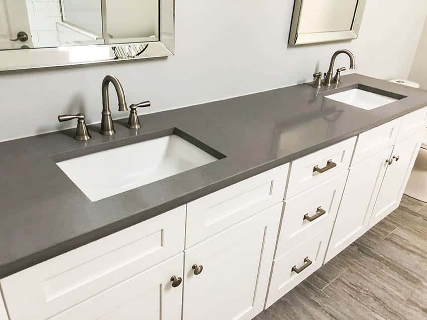 Bathroom with double sink vanity with brass finish faucets