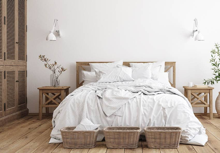 Beautiful bedroom with bamboo sheets queen sized bed wicker baskets at foot of bed